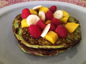 Avocado pancakes with fruit on plate