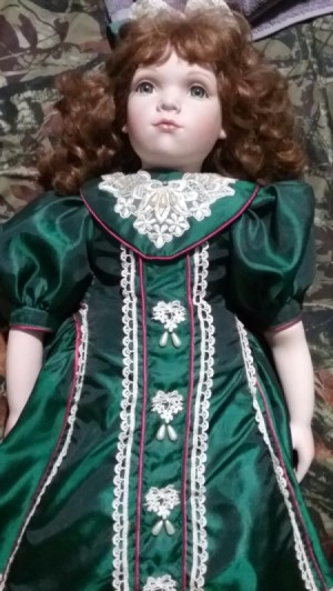 Identifying a Porcelain Doll - doll with red hair and wearing a green satin dress