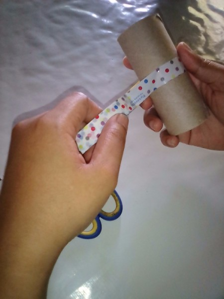 Recycled Tissue Roll for Small Gift Wrapping - wrap a piece of washi tape around the center of the TP roll