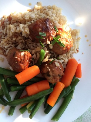 Teriyaki Meatballs on plate with rice and vegetables