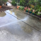 Wet Concrete to Stay Cool - spraying water on patio
