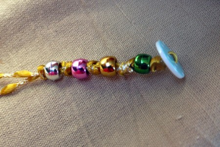 Button and Bead Knotted Bracelet - continue adding beads and knots until it fits around your wrist