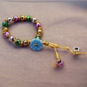 Button and Bead Knotted Bracelet - - fasten the bracelet using the button