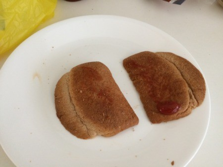 Two bread heels being made into a sandwich.