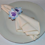 Easy Floral Lace Serviette Rings - place setting with napkin in serviette ring on white plate