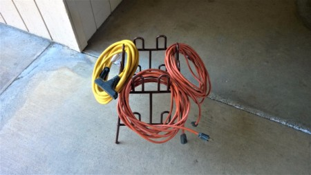How to Reuse a Plastic Shoe Rack - coils of electrical cords hanging