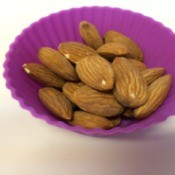 A portion of almonds in a silicone muffin cup.