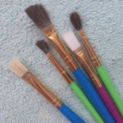A collection of paint brushes of different sizes.