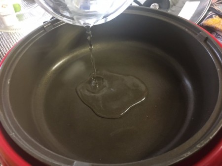 pouring water in pan