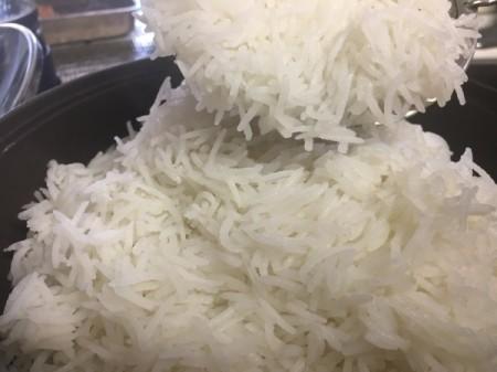 adding rice to potato slices