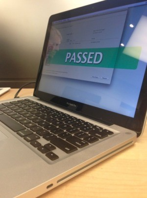 """An Apple MacBook Pro laptop computer that says """"Passed"""" on the screen."""