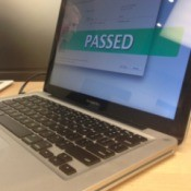 "An Apple MacBook Pro laptop computer that says ""Passed"" on the screen."