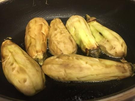 peeled eggplant in pan