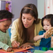 A childcare provider working with children.