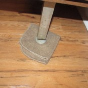 A washcloth under the leg of a heavy piece of furniture, to assist in moving it.