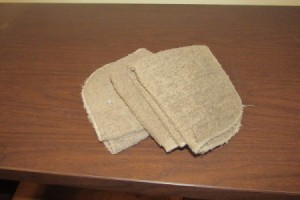 A stack of washcloths, to be used in moving furniture.