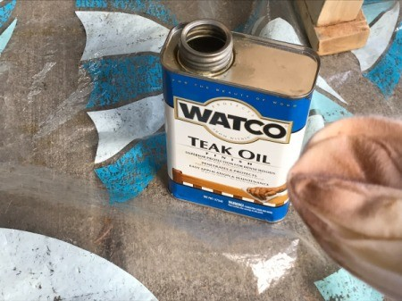 Refinishing Teak Outdoor Furniture - can of teak oil and cloth