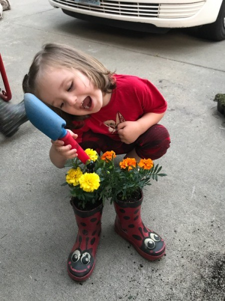 Rubber Boot Planter - little boy admiring his planted boots