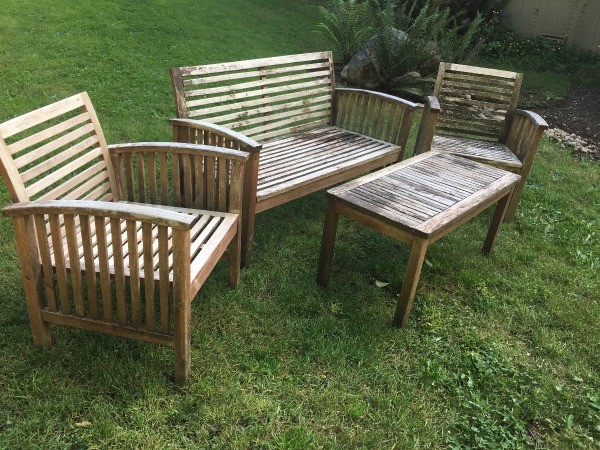 Refinishing Teak Outdoor Furniture - furniture set before cleaning - Refinishing Teak Outdoor Furniture ThriftyFun