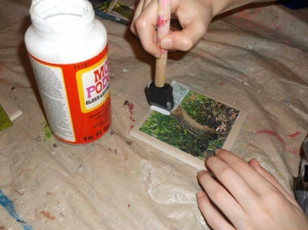 Picture Tile Coasters - painting a coat of mod podge on picture