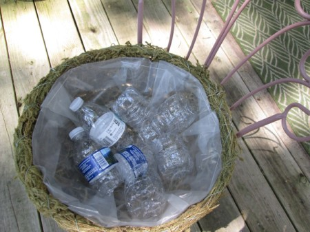 Thrift Store Garden Chair Planter - add plastic water bottles to basket