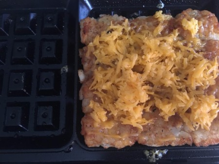 Cheese added to tater tot waffle