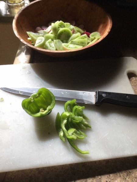 slicing green peppers