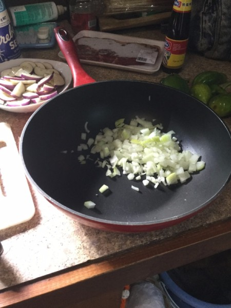 sliced onion in wok