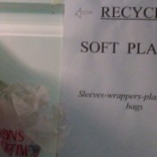 Signs for where to recycle plastics.