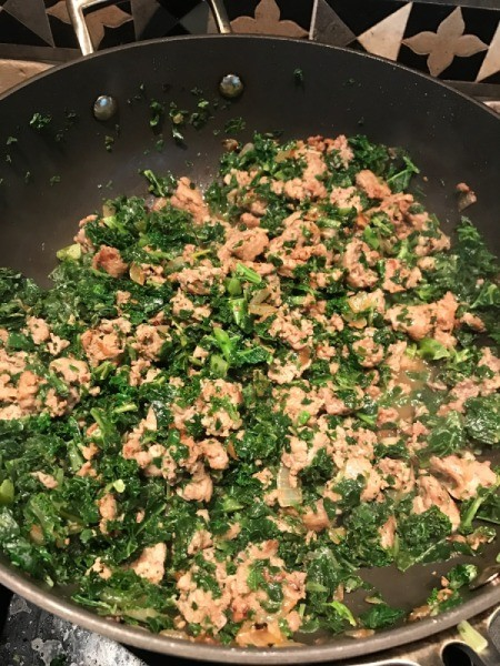 cooked spinach, kale, sausage and onion in pan