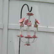 Making A Solar Outdoor Chandelier - hanging on a plant hanger in garden