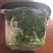 Saran wrap on top of a reusable food container before the lid is placed.