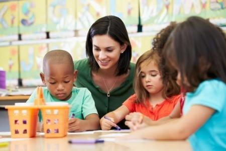 A childcare professional teaching children.