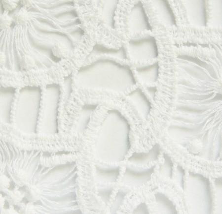 White crochet material.