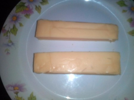 cheese block sliced in half lengthwise