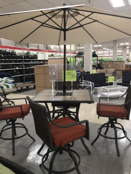 Patio furniture deals at a store closing sale.