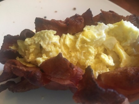 Woven Bacon Shell with egg and cheese added on plate