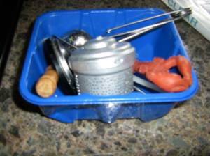 A blue packaging container for mushrooms, used to organize a drawer.