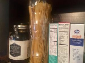 Spaghetti stored in 2-liter plastic soda bottles, in the pantry.