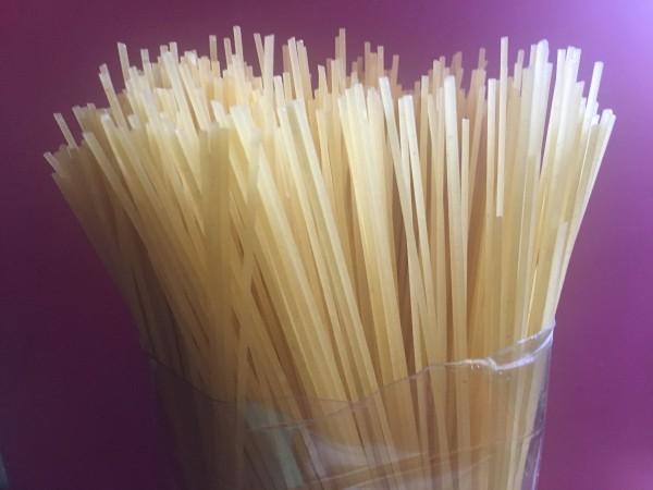 Spaghetti stored in 2-liter plastic soda bottles.