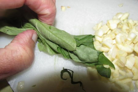 rolled basil leaves and garlic