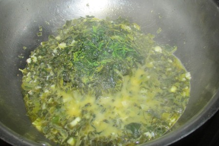 spinach and herbs in pan
