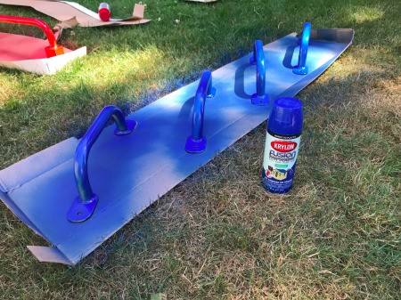 Refinishing a Wooden Playground - blue handles