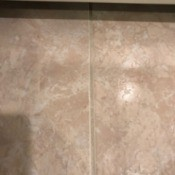 A clean grout line on a tiled floor.