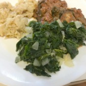 Sautéed Kale on plate with meat and potatoes