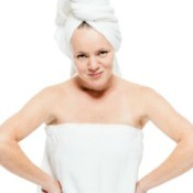 A woman wrapped in a white towel.