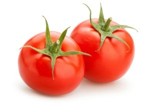 Two beautiful red tomatoes.