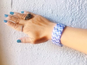 Plastic Bottle and Washi Tape Bracelet - final view of bracelet being worn with other jewelry