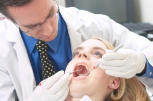 A woman being examined by a dentist.