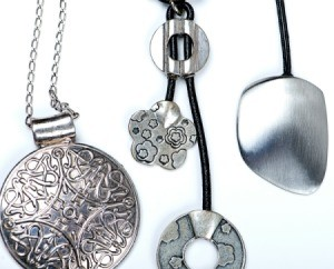 Photo of silver jewelry.